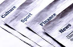 Newspaper sections. About news, finance, sport, culture Stock Photography