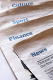 Newspaper sections. About news, finance, sport, culture Stock Photos
