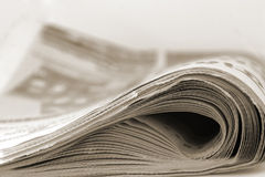 Newspaper in sepia. Closeup of a newspaper in sepia Royalty Free Stock Images
