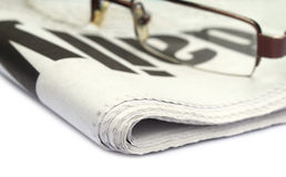 Newspaper with spectacles Royalty Free Stock Photos