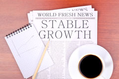Newspaper STABLE GROWTH Stock Photo