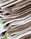 Newspaper stack. A stack of newspapers with focus on front Royalty Free Stock Image
