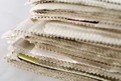 Newspaper Stack. On white background stock photography