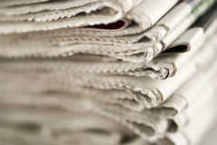 Newspaper Stack. On white background stock image