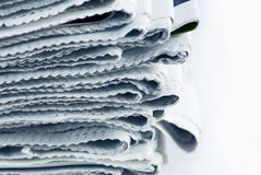 Newspaper Stack. On white background stock photos