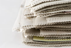 Newspaper Stack. On white background royalty free stock image