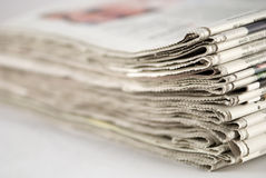 Newspaper Stack. On white background stock photo