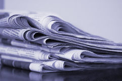 Newspaper stack Stock Images