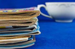 Newspaper stack on blue background Royalty Free Stock Photos