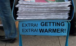 Newspaper stack getting warmer. Take one of these newspaper in the subway entrance Stock Photography