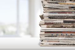 Newspaper. Stack Print Media Heap Vertical Close-up White Background Stock Photo
