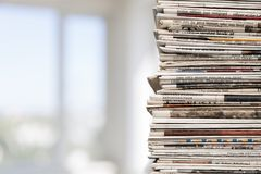 Newspaper Stack. Print Media Heap Vertical Close-up White Background Folded Stock Photo