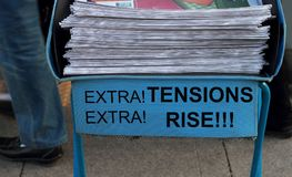 Newspaper stack- Tension Rise headline. Concept Stock Photos