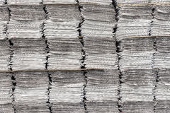 Newspaper stacks background. Horizontal shot of multiple stacks of newspapers as background stock photo