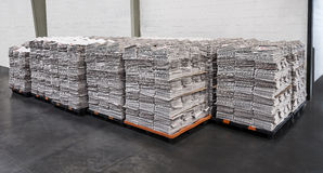 Newspaper stacks on pallets in warehouse Stock Images