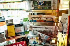 Newspaper stand with Financial Times, The New York Times royalty free stock photo
