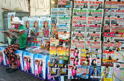 Newspaper stand on pavement Stock Images