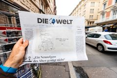 Newspaper about Stephen Hawking Death on the first page portrait. PARIS, FRANCE - MAR 15, 2018: German Die Welt newspaper with caricature of Stephen Hawking Royalty Free Stock Photos