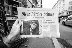 Newspaper about Stephen Hawking Death on the first page portrait. PARIS, FRANCE - MAR 15, 2018: German Neue Burcher Zeitung newspaper with portrait of Stephen stock photo