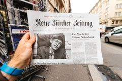 Newspaper about Stephen Hawking Death on the first page portrait. PARIS, FRANCE - MAR 15, 2018: German Neue Burcher Zeitung newspaper with portrait of Stephen Royalty Free Stock Photography