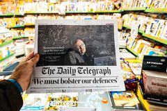 Newspaper about Stephen Hawking Death on the first page portrait. PARIS, FRANCE - MAR 15, 2018: International newspaper Daily Telegraph with portrait of Stephen Stock Photography