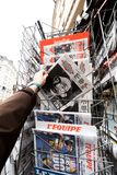 Newspaper about Stephen Hawking Death on the first page portrait. PARIS, FRANCE - MAR 15, 2018: Man buying French newspaper with portrait of Stephen Hawking the Royalty Free Stock Images