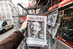 Newspaper about Stephen Hawking Death on the first page portrait. PARIS, FRANCE - MAR 15, 2018: Man buying French Liberation newspaper with portrait of Stephen Royalty Free Stock Image