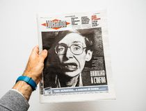 Newspaper about Stephen Hawking Death on the first page portrait. PARIS, FRANCE - MAR 19, 2018: Man reading French Liberation newspaper with portrait of Stephen Royalty Free Stock Photo