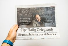 Newspaper about Stephen Hawking Death on the first page portrait. PARIS, FRANCE - MAR 15, 2018: POV at International newspaper The Daily Telegrph with portrait Stock Image