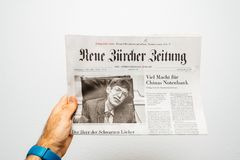 Newspaper about Stephen Hawking Death on the first page portrait. PARIS, FRANCE - MAR 15, 2018: POV at Swiss Neue Burcher Zeitung newspaper with portrait of Stock Photo
