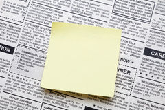 Newspaper and sticky note. Fake Classified Ad, newspaper and sticky note royalty free stock photography