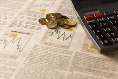 Newspaper stock market with calculator and money Stock Photography