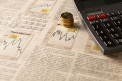 Newspaper stock market with calculator and money Royalty Free Stock Images