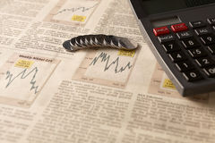 Newspaper stock market with calculator and money Stock Images