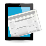 Newspaper and tablet Royalty Free Stock Image