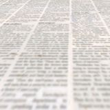 Newspaper with old vintage unreadable paper texture background. Newspaper texture with old unreadable text. Vintage blurred paper news square background royalty free stock images