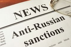 Newspaper with title Anti-Russian sanctions. Newspaper with word news and Anti-Russian sanctions royalty free stock photography