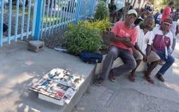 Newspaper vendor, Honiara, Solomon Islands. Honiara, Solomon Island - March 7th, 2017: A street vendor selling local newpapers from Solomon Island across the Royalty Free Stock Photo