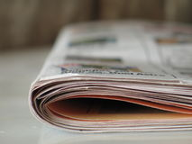 Newspaper view. A newspaper that is resting on the floor stock photos