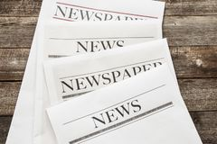 Newspaper on wooden background royalty free stock photography