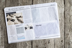 Newspaper on wooden table. Newspaper on the wooden table stock image