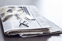 Newspaper on wooden table Royalty Free Stock Image