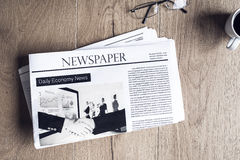 Newspaper on wooden table Stock Photos