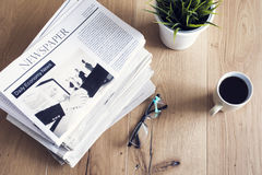 Newspaper on wooden table Stock Photo