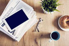 Newspaper on wooden table Royalty Free Stock Photos