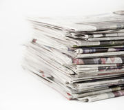 Newspapers 1. Stack of newspapers on a white background royalty free stock image