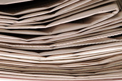 Newspapers. A Stack of folded Newspapers Stock Image