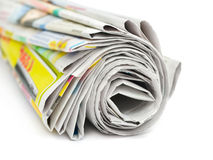 Newspapers. Roll of newspapers isolated on white background Royalty Free Stock Images
