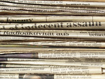 Newspapers. Detail of a pile of international newspapers Stock Photos