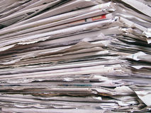 Newspapers. Closeup of a stack of newspapers royalty free stock image